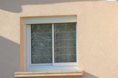 Fenêtre coulissante ALU avec volet roulant
