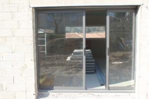 Porte-fenêtre coulissante galandage