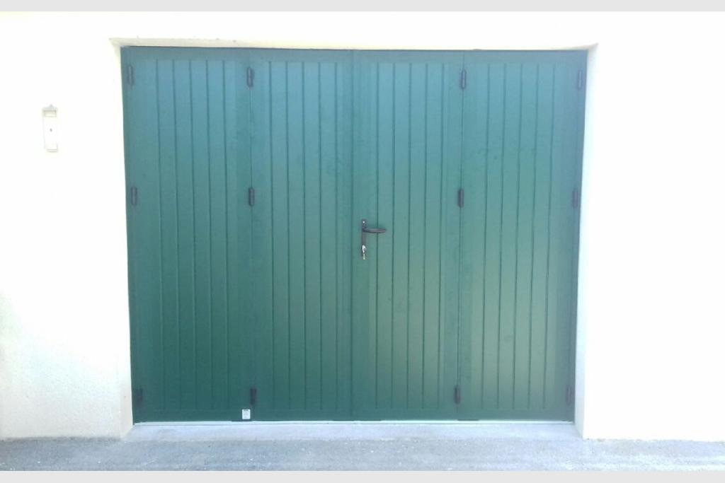 Porte de garage battante aluminium